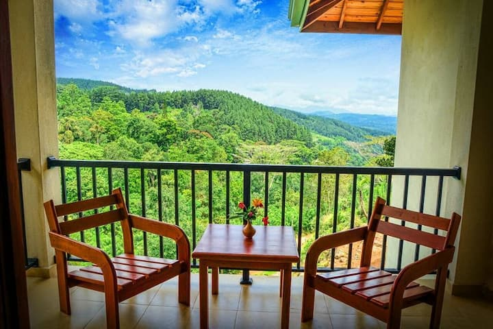 Deluxe triple room with balcony and mountain view.
