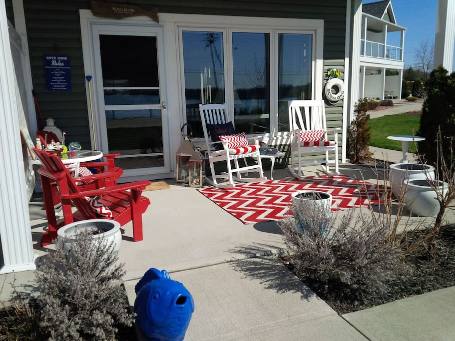 This beautiful covered porch looks at the river and is perfect for morning coffee or a glass of wine to watch the amazing sunsets over the St. Clair River
