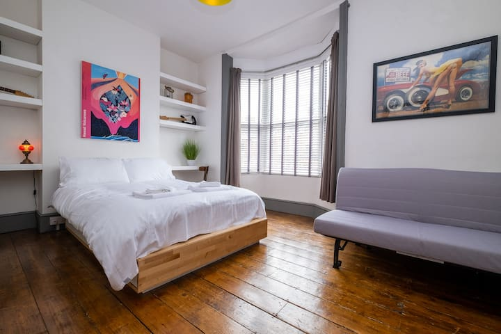 BEDROOM 1 - Double bed and sofa bed on the first floor with some stunning pieces of art.