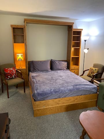 Queen solid oak Murphy bed with new mattress