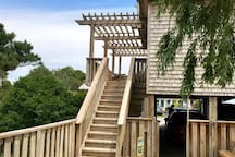 The gate to carport from pool area Steps go up to the deck and entrance to your suite .