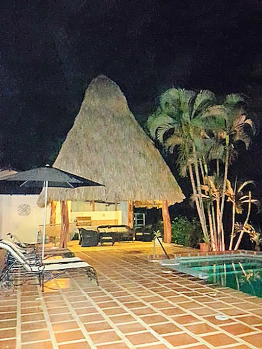 Night view of common/palapa/pool/patio area