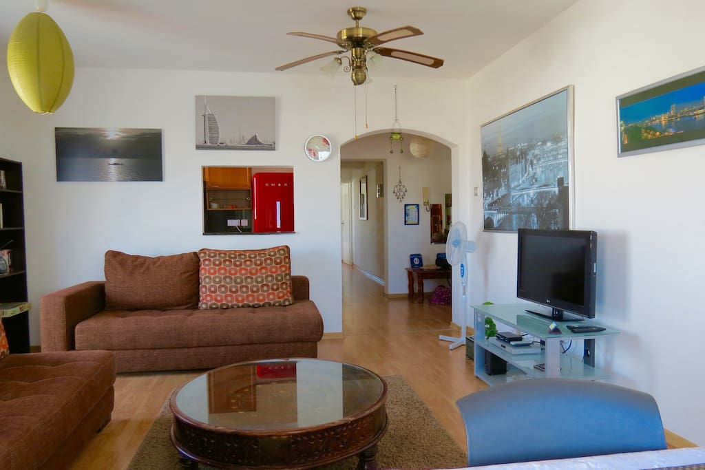 very big lounge with modern comfortable sofas, Internation TV channels, air con, flyscreens and great views