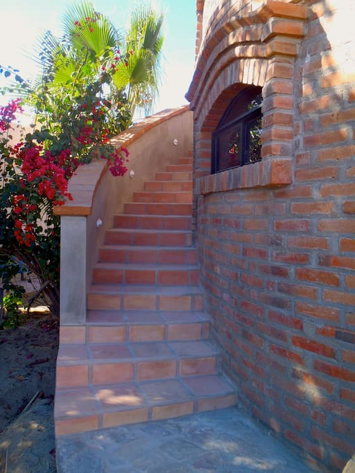Outdoor stairs to the upstairs palapa-shaded space.