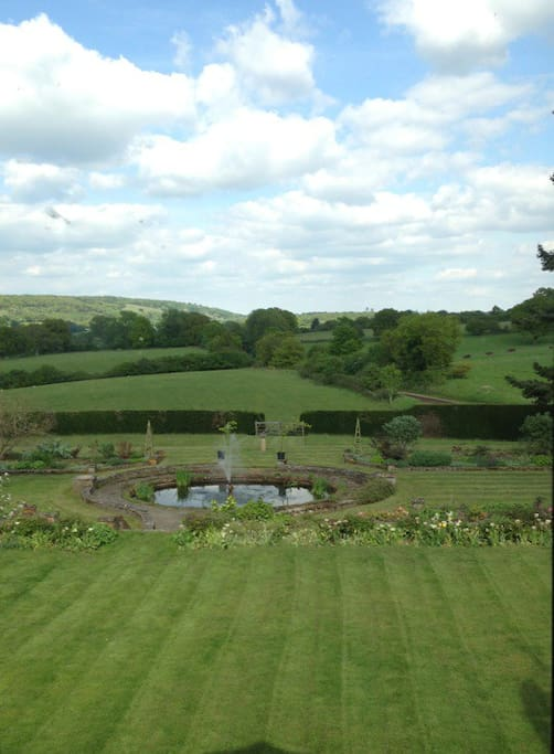 Uninterrupted views to the North Downs across flower filled gardens