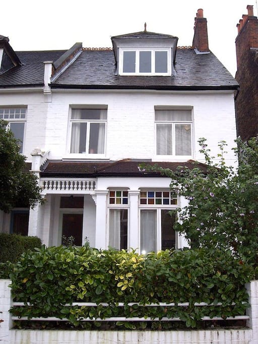 THE house; the apartment is on the ground floor with a lovely front and back garden.