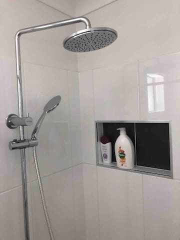 Luxury shower with multiple shower heads and great water pressure!