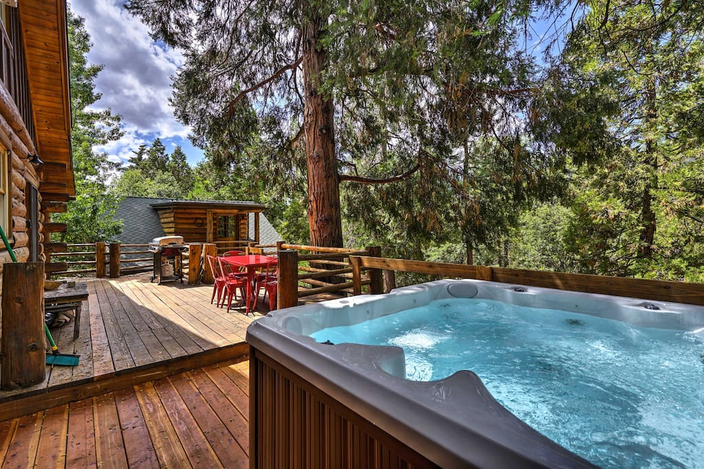 The tree-surrounded property features a brand new hot tub and multiple patios.