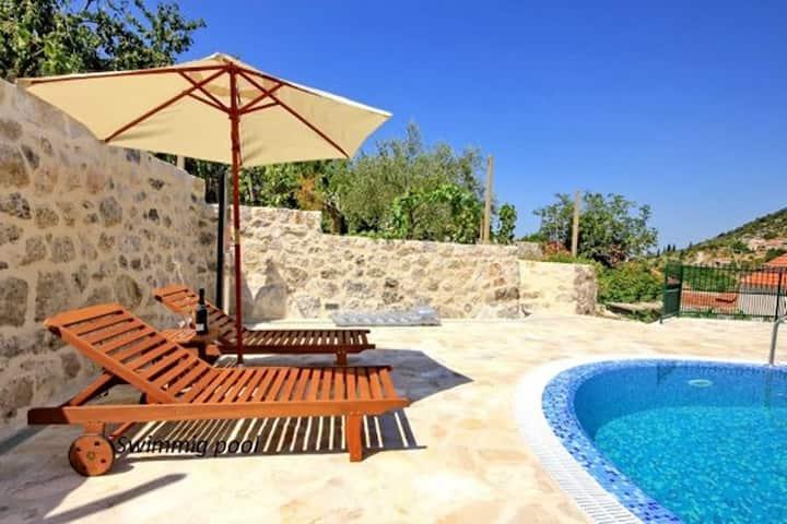 Dalmatian stone villa with pool, Os