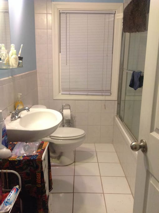Shared bathroom, spacious with shower and tub.