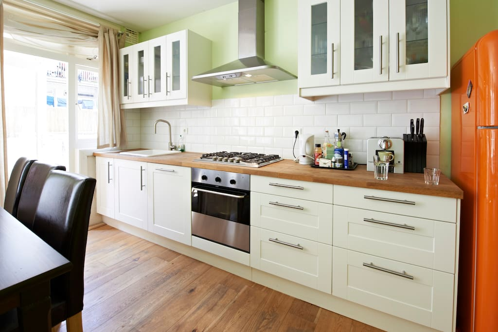 The kitchen is fully equipped with a dish washer, oven, fridge, espresso machine, and everything you need to cook a great meal!