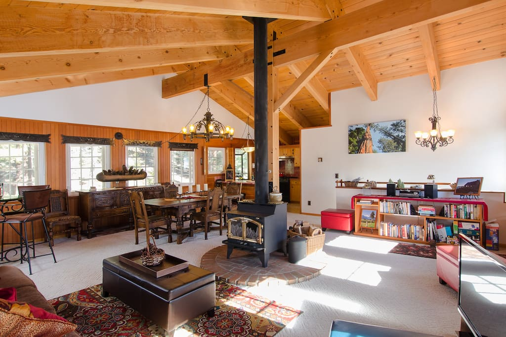 The Great Room: Primary hangout surrounded by windows on both sides with a wood burning stove in the center.