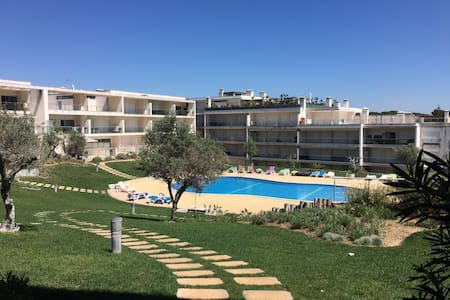 Comfy apartment with Pool   near Beach & Golf