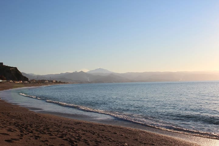 The sandy beach of Villafranca Tirrena is only 5mins drive down the hill