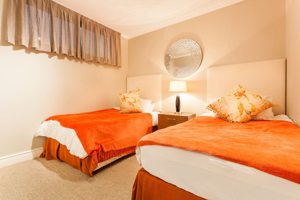 This is the room with twin single beds. Please note there is only the one window on the left that is open to the passageway so it does not get direct views or light.