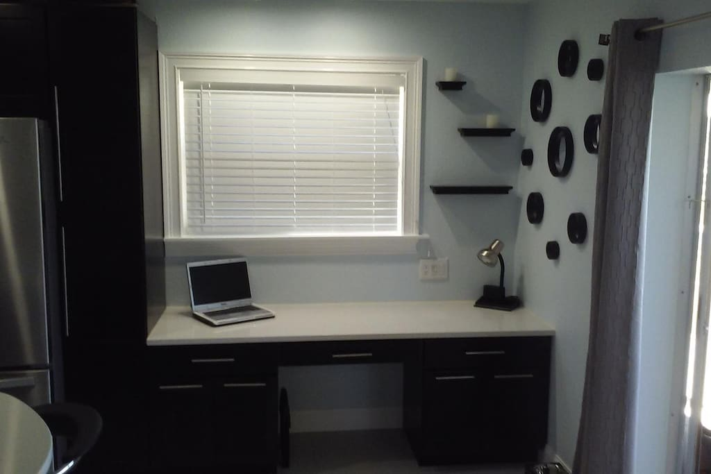 Desk area next to kitchen and porch