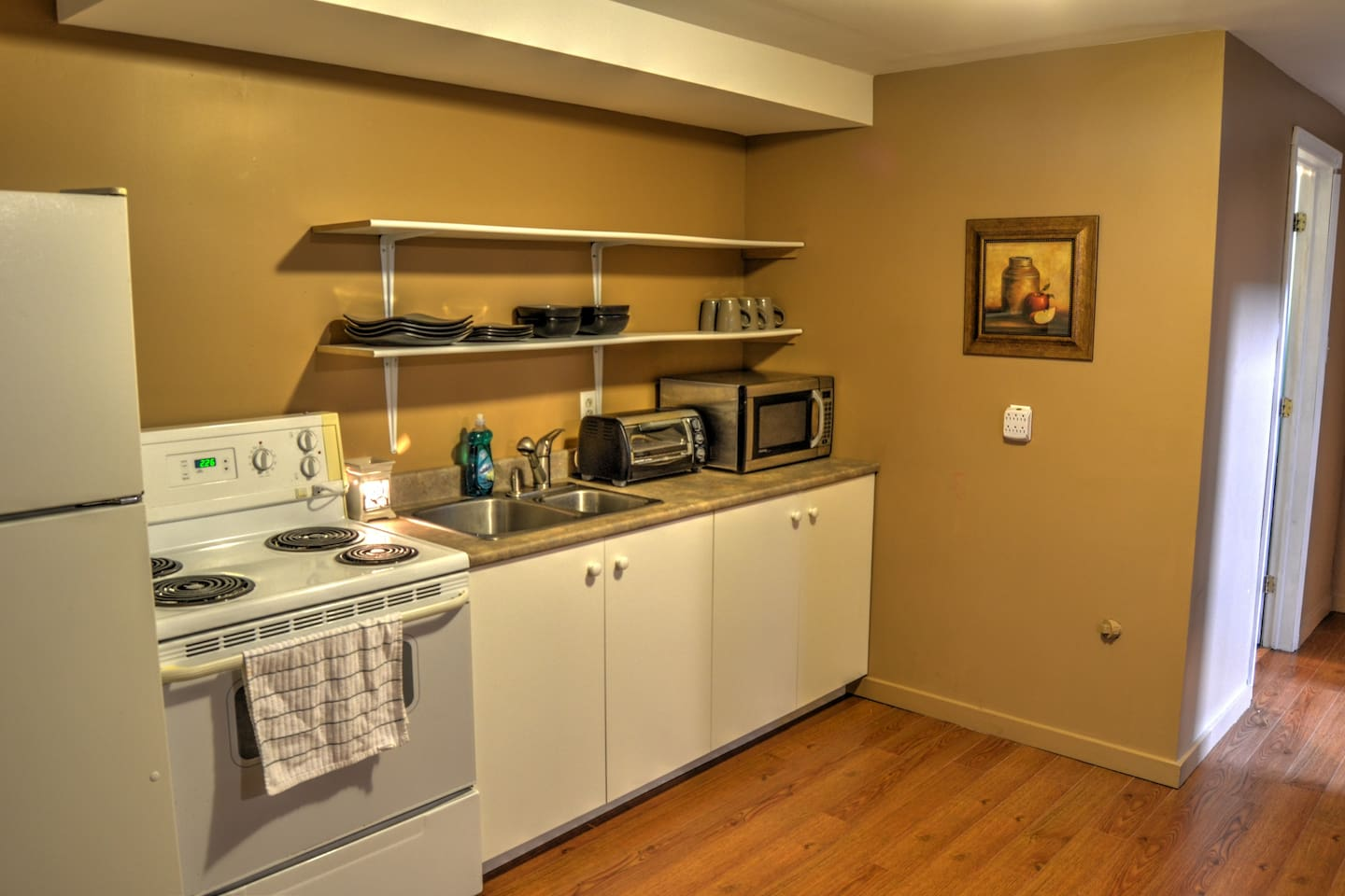 Welcome to your cute and cozy kitchen with everything you need!