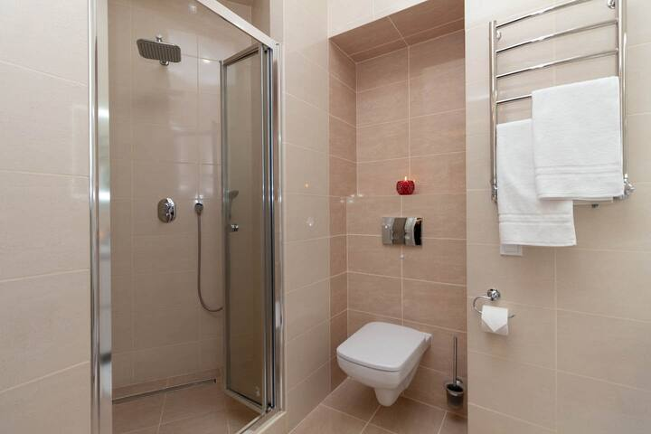 Enjoy the spacious shower with its rainfall shower head