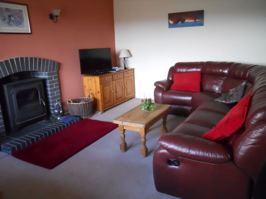 Comfortable sofa and  log burner.