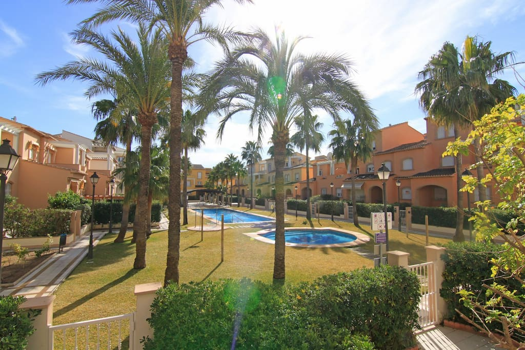 Overlooking lovely landscaped gardens and communal pools