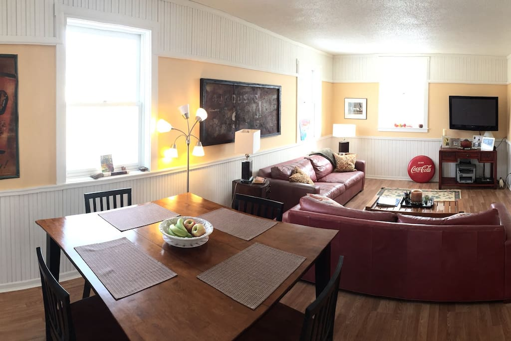 Open floor plan with comfy couches, wifi and direct tv.