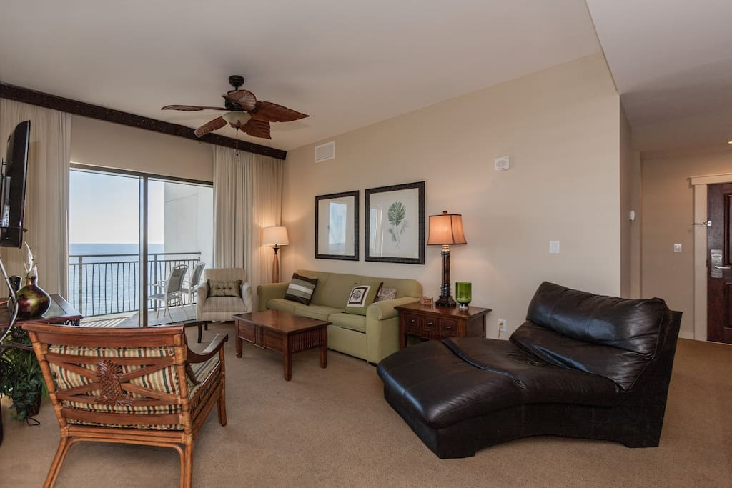 "Plenty of seating, sofa sleeper, and 54"" flat screen TV in the living room. Complimentary Wi-Fi also provided."