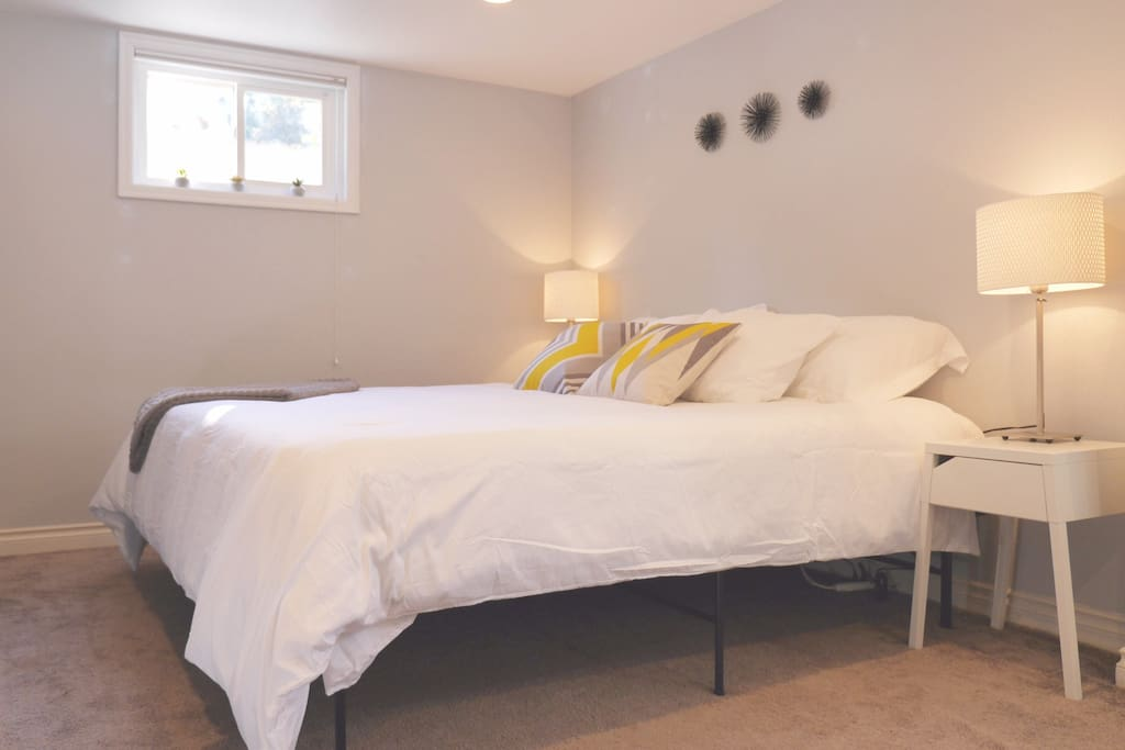King sized bed with fluffy white linens!