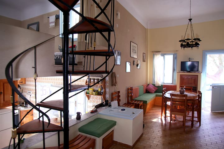 Living room, featuring the staircase
