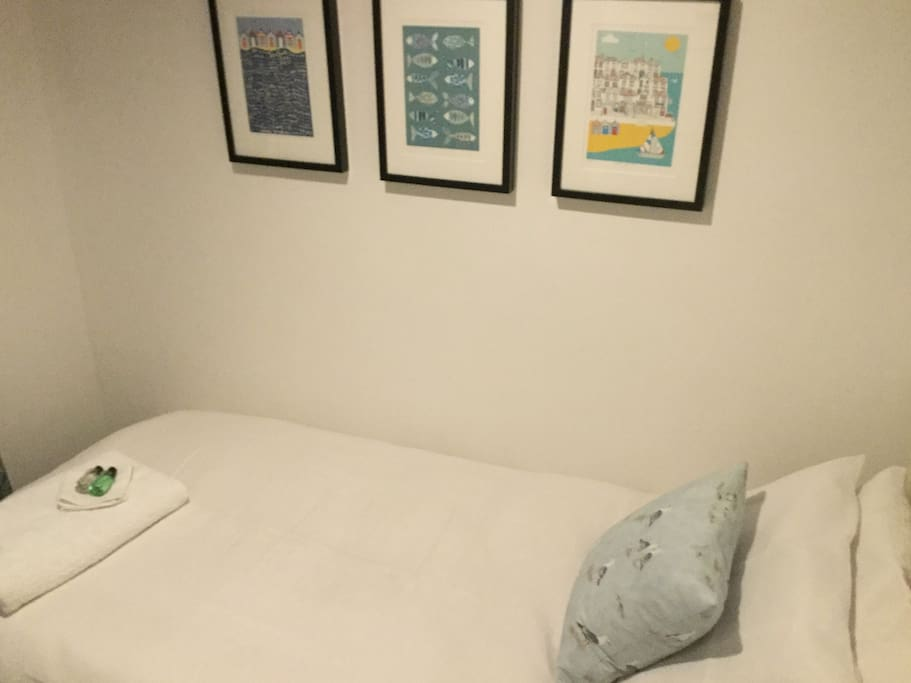 Bed is full adult size with proper memory foam mattress and quality bedding