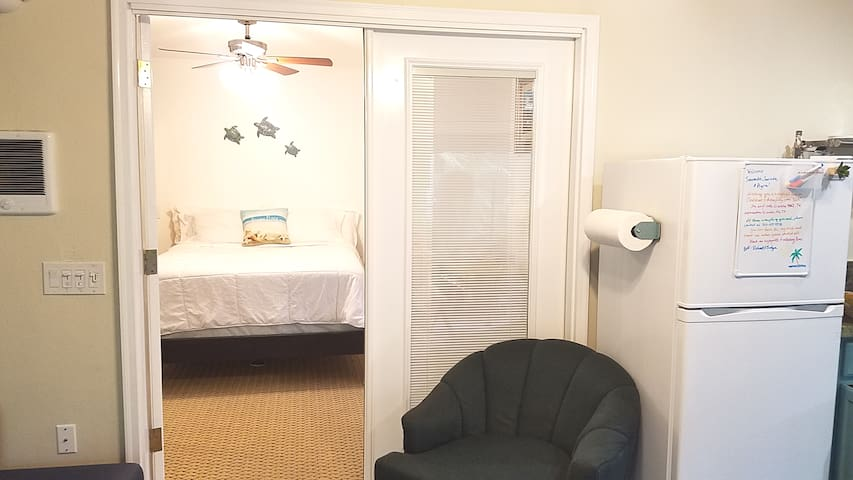 Glassed French doors with adjustable Louvre separate bedroom and living room- kitchenette area