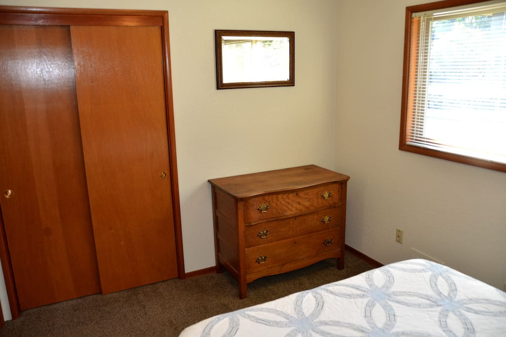 Your bedroom has a large antique dresser with TONS of room for your stuff.