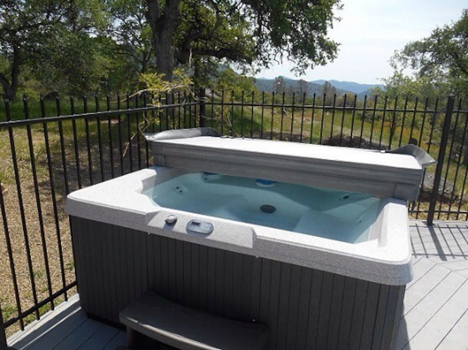 Bubbling hot tub with a view; just steps away from the pool.