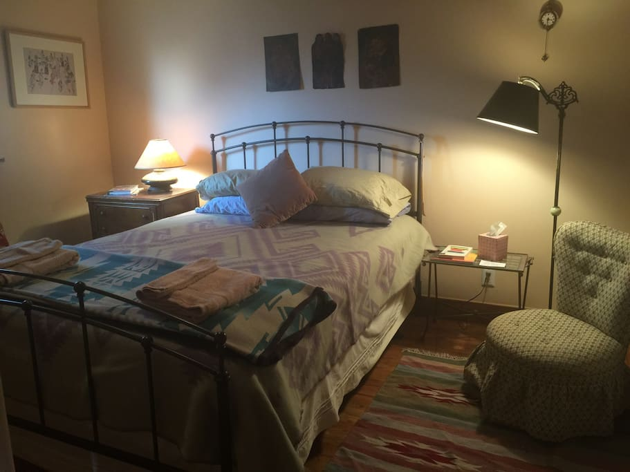 Queen size bed, and folk art in Bedroom