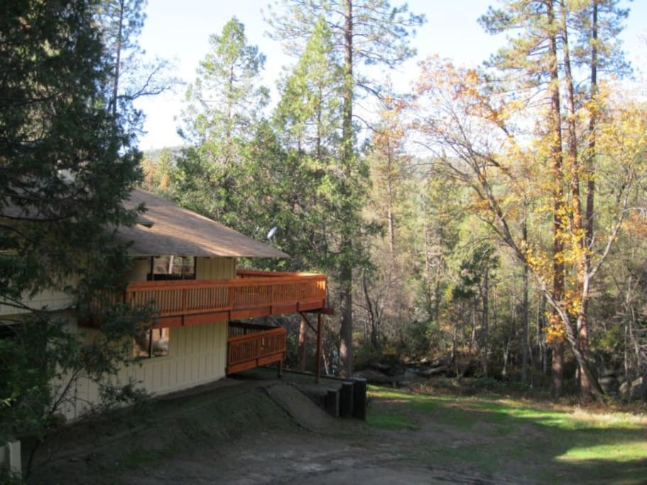House overlooks Lewis Creek, with access from lower deck.