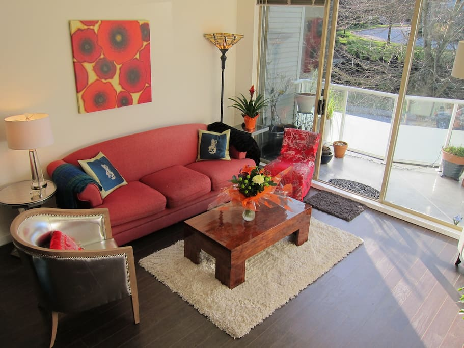 Living room is bright and inviting. Sofa is great for naps or an extra guest.
