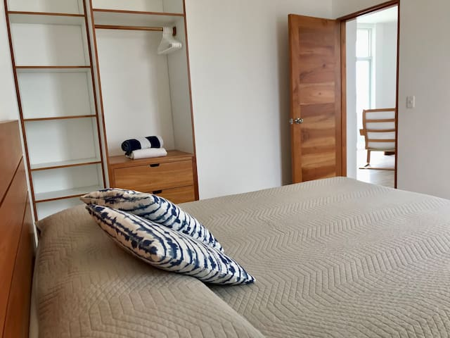 Bedroom with queen size bed and closet space