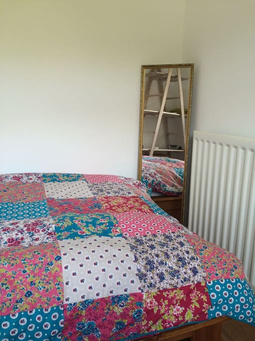 A full length mirror and radiator at the end of the bed.  Feel free to move the mirror to suit your needs.