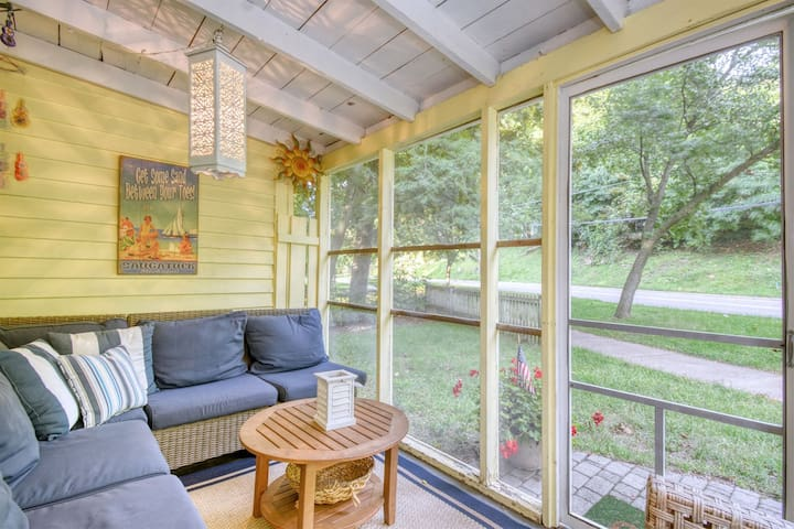 Sunshine Cottage: Watch the world go by from the screen porch of this happy bungalow in the heart of downtown Saugatuck