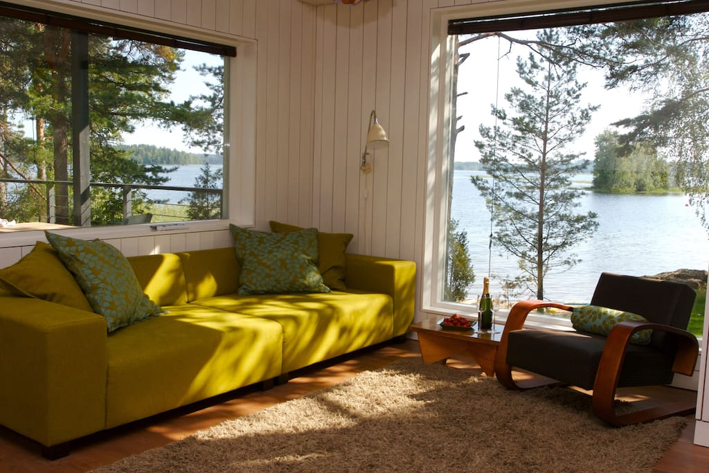 Main villa´s living room. View to the lake Saimaa.