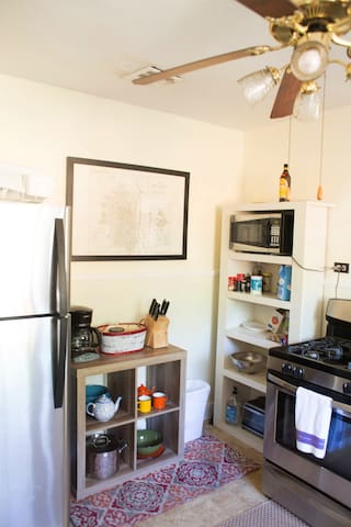 Kitchen--coffee maker & coffee supplies, gas stove, fridge, microwave, basic cooking needs