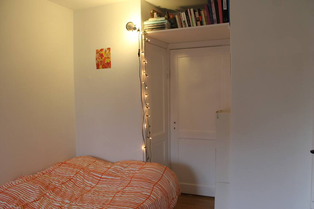 Double bed, with a double duvet. The door on the right is to the hallway.