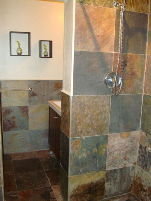 Slate bathroom with large shower head