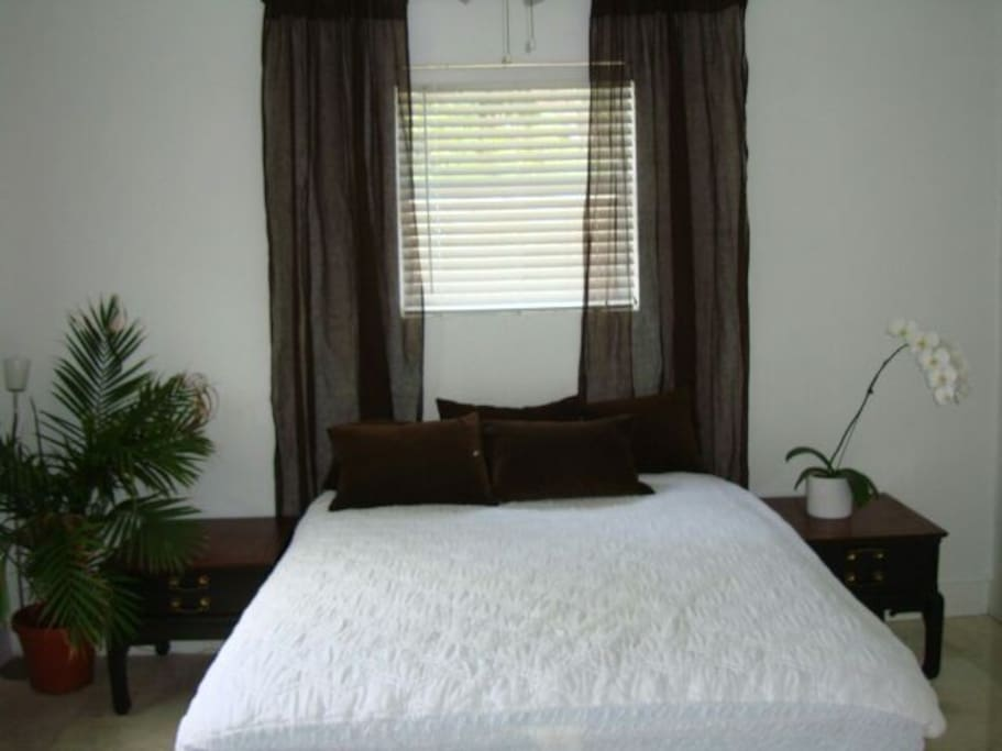 Queen size bed with ac and tv