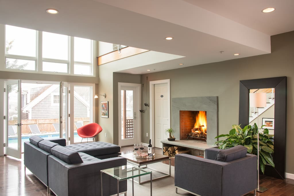 The open and airy Great Room with a wood burning fireplace is welcoming in all four seasons