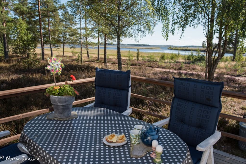 Breakfast on the porch with a lake view