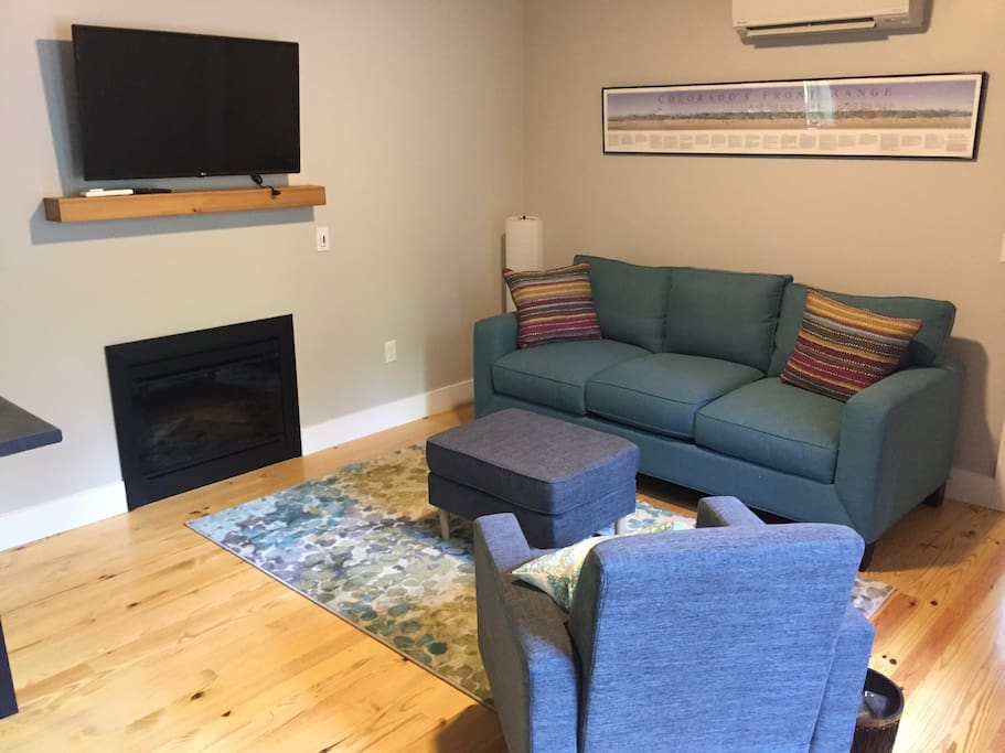 Living area with fireplace and wifi enabled TV. Log into your Netflix or Amazon video accounts right from tv.