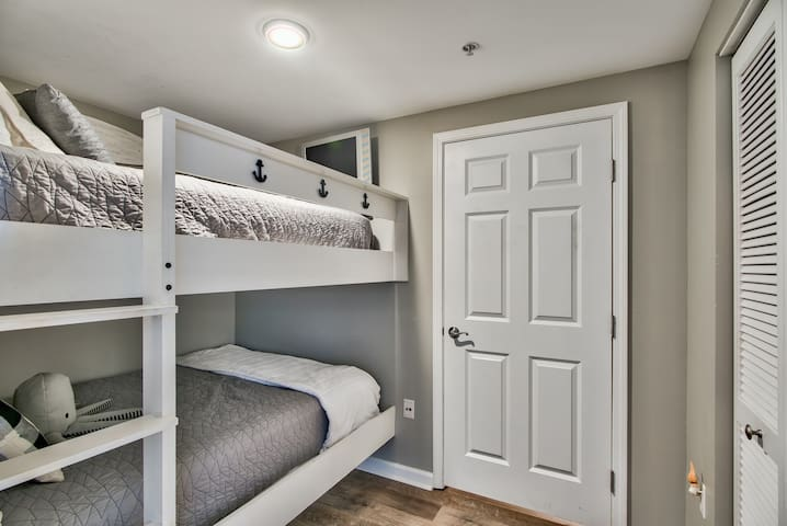 Full Size Mattress Bunk Beds. Perfect for children. Full size Washer and Drier in this room.