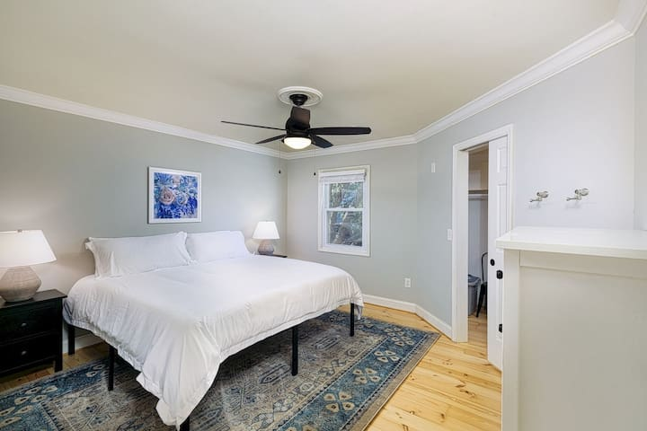 Private bedroom with king sized bed, huge walk-in closet, 2 night stands and a dresser with mirror.