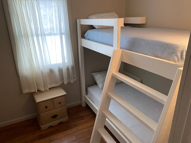 This small all-season bedroom on the first floor has bunk beds.  This room does not have insulation, but you will stay toasty warm with the use of the provided space heater.