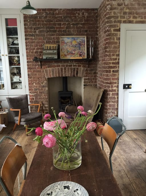 The wood burner stove and sitting area in the kitchen